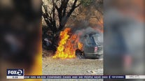 CHP officer pulls driver from burning car