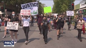 More than 100 protesters march through Walnut Creek