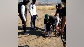 VIDEO: High school football players help man in wheelchair up Mission Peak