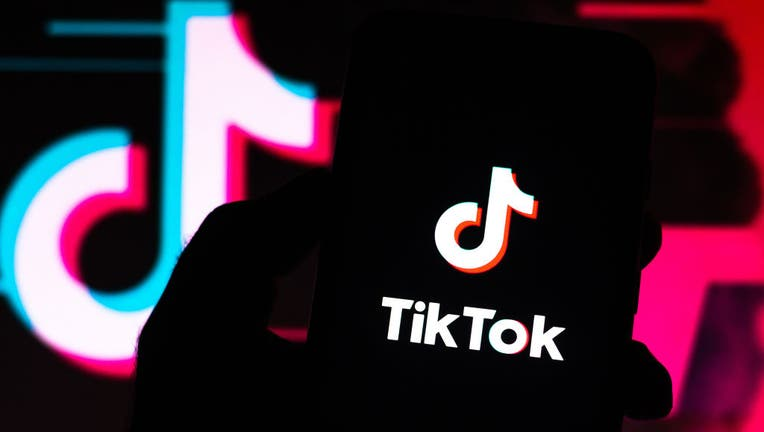 FILE - In this photo illustration a TikTok logo seen displayed on a smartphone.