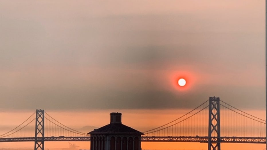 Sunrise in the Financial District amid smoke