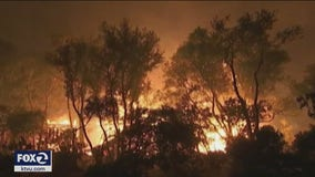 CA governor rips 'climate change deniers' as wildfires rage