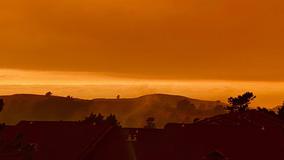 Wildfires cast eerie orange shade over Bay Area skies
