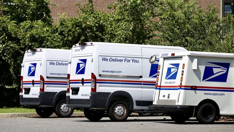 FILE - Vehicles of US Postal Service (USPS) is seen in New York, USA on August 18, 2020.