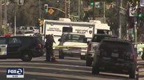 Double homicide suspect still barricaded inside Oakland building