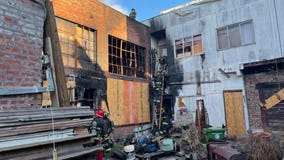 Oakland firefighters quickly contain blaze at red-tagged building