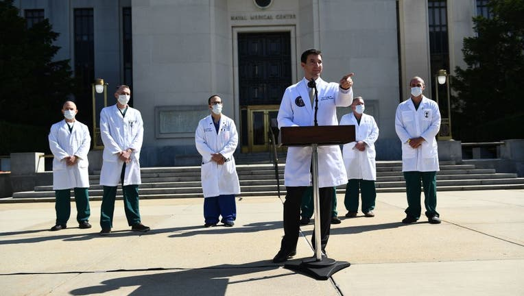 FILE - White House physician Sean Conley answers questions surrounded by other doctors, during an update on the condition of US President Donald Trump, on October 4, 2020, at Walter Reed Medical Center in Bethesda, Maryland.
