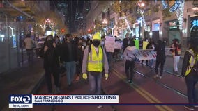 Demonstrators march on Market Street against San Francisco police shooting