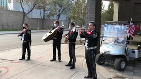 Election Day: Mariachi bands play for voters waiting in line