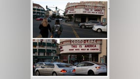 20 years later: marquee at famous Oakland theater displays same message