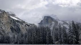 Snow blankets Yosemite National Park, helping to 'mellow fire behavior' in area