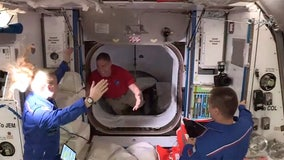 SpaceX capsule with 4 astronauts docks with space station