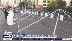 Glide Church turns San Francisco street into block-long dining room for Thanksgiving