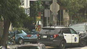 Car crashes into San Francisco home after police chase; officers injured