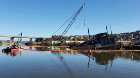 Crews work to limit petroleum spill from sinking barge in Petaluma