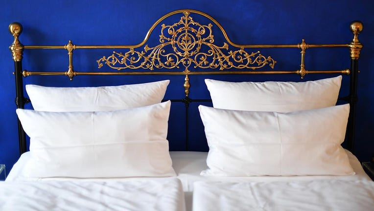 A file image dated July 14, 2016 shows a bed in a boutique hotel. (Photo by Jens Kalaene/picture alliance via Getty Images)