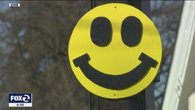 High school senior cheers up Danville by hanging smiley faces