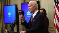 Biden signs executive orders focused on battling COVID-19