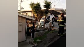 Car crashes into residential carport, goes over embankment