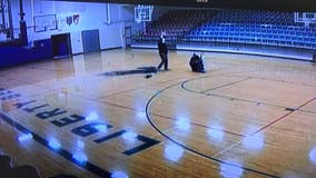 'Nothing but net': School custodian sinks half-court shot with back turned
