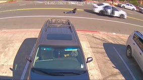 Woman dragged by car during purse theft