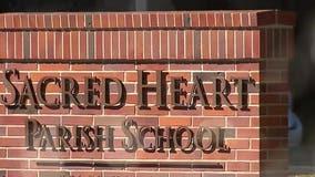 Catholic school kicks out kids after mom posts explicit photos online