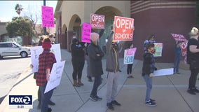 Oakley parents hold protest to reopen schools after viral hot mic moment