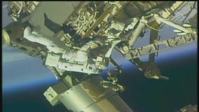 Spacewalking astronauts prep ISS for new solar wings