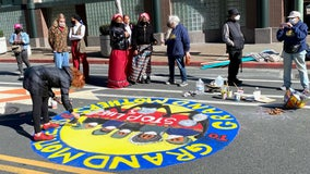 Hundreds paint murals on downtown Oakland street opposing oil pipelines