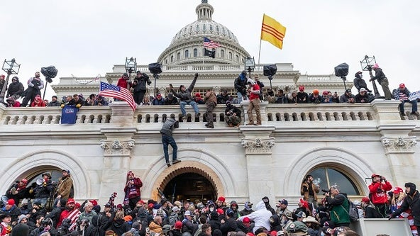 More than 300 people have been charged after deadly US Capitol riot, Justice Dept. says
