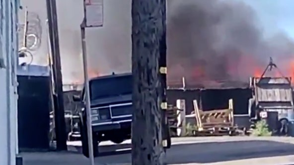 Oakland firefighters extinguish blaze that destroyed RV, several trailers
