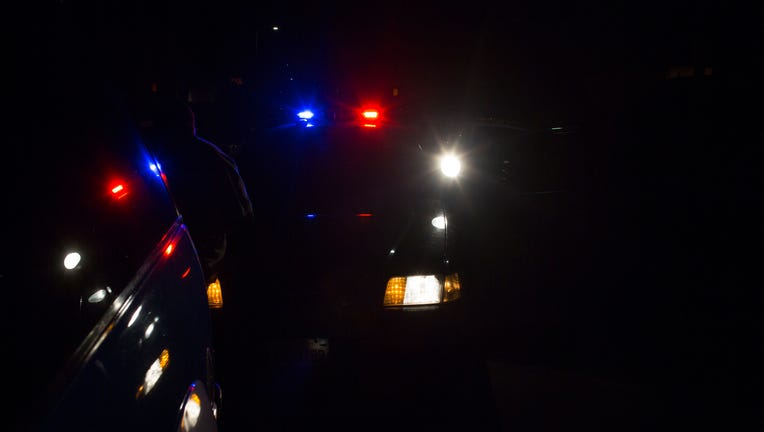 A file image shows lights flashing on a police car during a traffic stop. (Photo credit: Robert Nickelsberg/Getty Images)