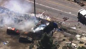 Oakland firefighters battle encampment blaze
