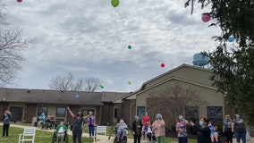 After enduring 1 year of COVID-19 pandemic, resilient nursing home residents release colorful balloons