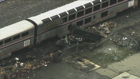 Dump truck bursts into flames after collision with Amtrak train in Oakland