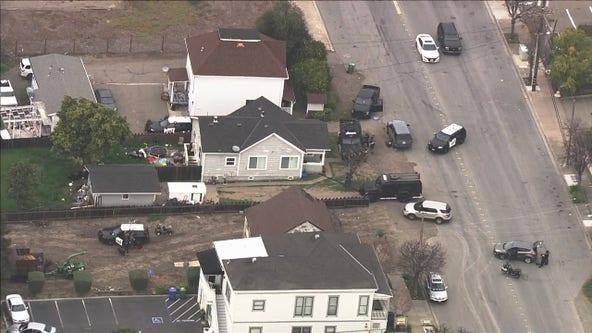 Fremont police have guns drawn on residence