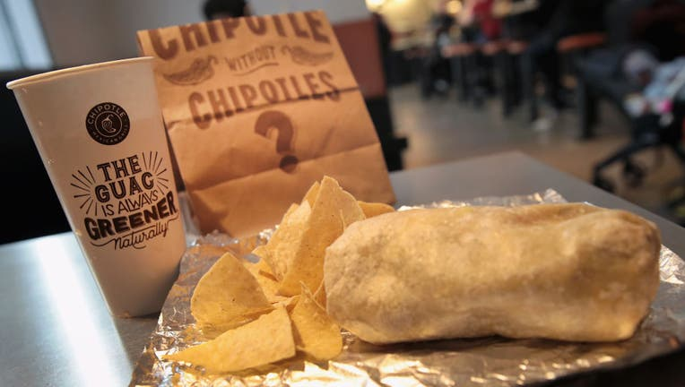 FILE - Food is served at a Chipotle restaurant on Oct. 25, 2017 in Chicago, Illinois. (Photo Illustration by Scott Olson/Getty Images)