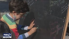 Grieving from recent gun violence, community members in San Francisco write kind messages in chalk