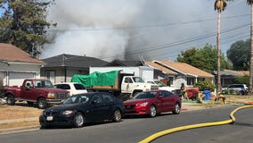 Firefighters working to contain house fire near Concord BART station