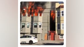 Flames shoot out from windows from Oakland apartment building near Lake Merritt