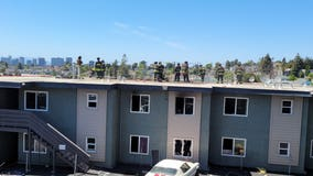 Oakland Fire Department contains 2-alarm blaze at apartment building