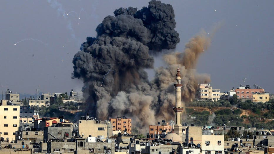 Smoke billows from Israeli air strikes in Gaza City, controlled by the Palestinian Hamas movement, on May 11, 2021. (Photo by ANAS BABA/AFP via Getty Images)