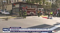 Firefighters rescue 20 people from burning building, all 60 residents displaced