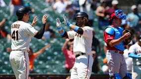 Flores hits two homers, Giants rout Phillies 11-2