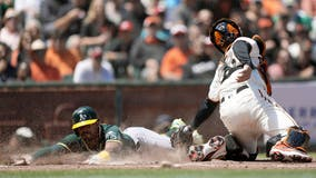 Irvin fans 8, A's beat Giants 6-2 to avoid 3-game sweep