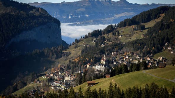 Swiss voters narrowly reject tax hike to fight climate change