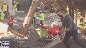 Gov. Newsom helps clean homeless encampment in Berkeley