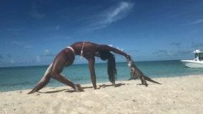 Video: Iguana bite ruins woman's yoga pose