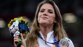 Polish Olympian auctions off medal to help fund baby's heart surgery