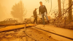 Newsom tours Greenville as Dixie Fire grows to single largest wildfire in state history